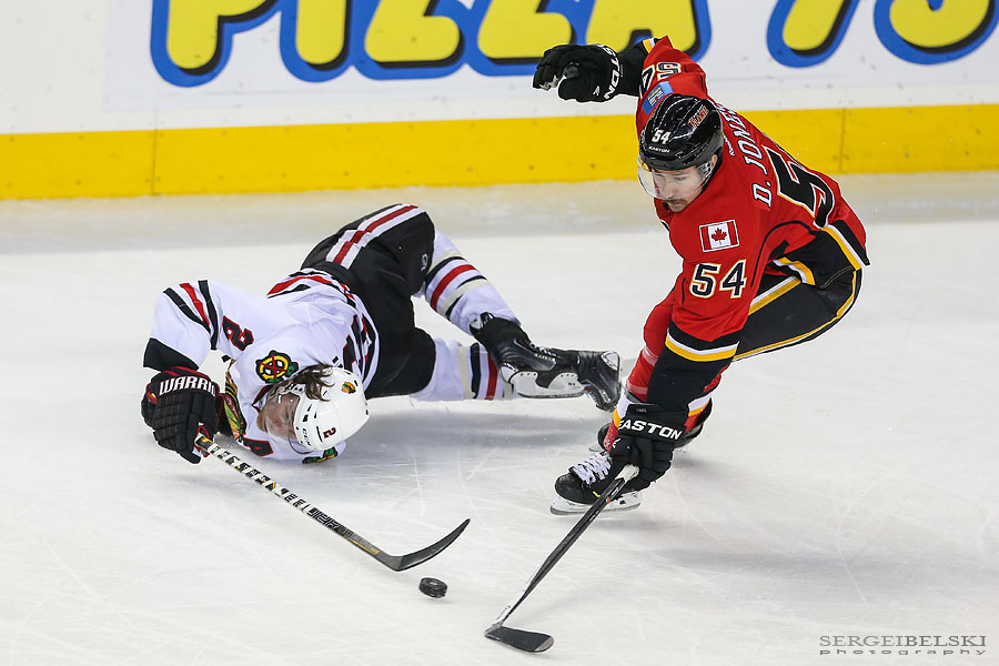 nhl hockey calgary flames vs chicago blackhawks sergei belski photo